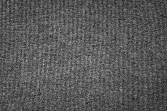Grey cotton texture background. Detail of sweater fabric surface.