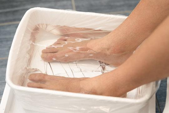 Male foot prepare for pedicure treatment