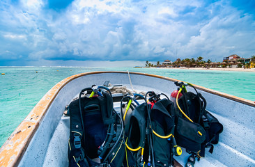 Boat with scuba diving equipment heading for dive in paradise, Mahahual, Yucatan, Mexico Wall mural