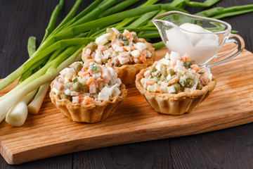 snack with ham, cheese, pepper and tomato in tartlets. Square. Concept of food, restaurant, catering, menu