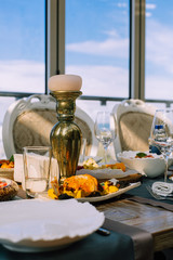 served table with food, empty glasses, white plates, wooden table, classy luxurious restaurant