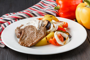 Grilled beef steak and baked vegetables