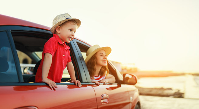 happy family mother and child boy goes to summer travel trip in car.