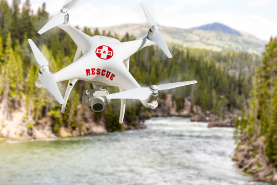 SAR - Search and Rescue Unmanned Aircraft System, (UAS) Drone Flying Above River in the Wilderness
