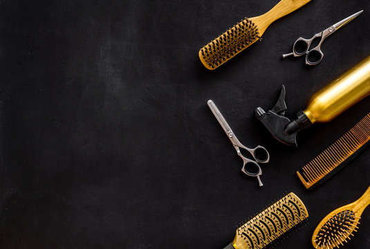 Combs and hairdresser tools in beauty salon work desk on black background top view mockup