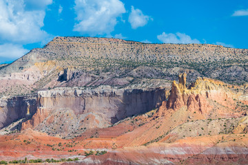 Colorful desert landscape with strata of yellow, orange, red, and purple in the American Southwest at Ghost Ranch, Abiquiu, New Mexico
