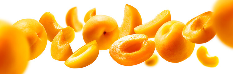 Apricots levitate on a white background. Ripe fruit in flight