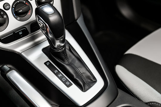 Close-up of the accelerator handle with silver metallic.  automatic transmission gear of car , car interior