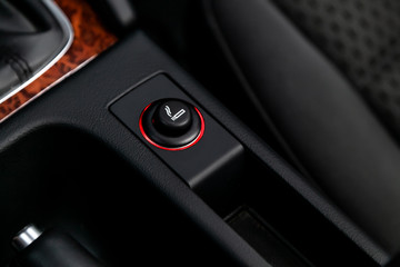 .Close up of the car cigarette lighter socket.modern car interior: parts, buttons, knobs..