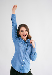 Successful young woman with hand raised