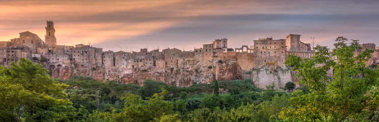 PITIGLIANO, TUSCANY, ITALY - JUNE 15, 2019 - View of Pitigliano town at sunset. Picturesque and...