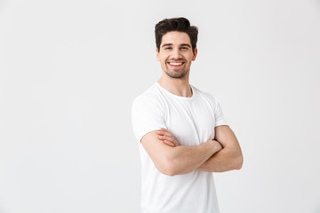 Happy young excited emotional man posing isolated over white wall background. Wall mural
