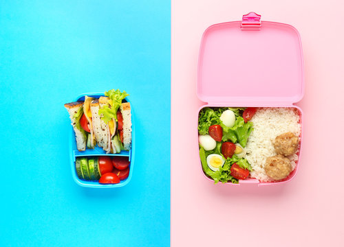 School lunch boxes with tasty food on color background