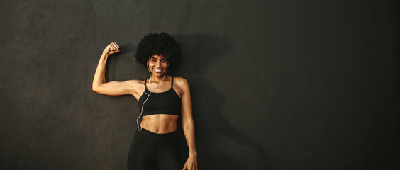 Woman flexing muscles and smiling