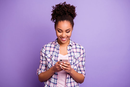 Portrait focused interested satisfied youth use modern technology blog blogger check social network account check read news beautiful plaid shirt stylish beautiful top-knot isolated purple background
