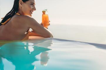 Woman enjoying a summer day in a pool