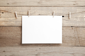 A4 mock up - A4 paper on a wooden background - blank A4 sheet on clothespins Wall mural