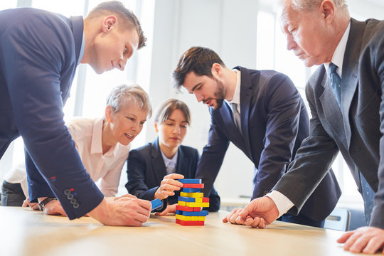 Business people make building blocks exercise