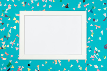 White frame on colorful table top view
