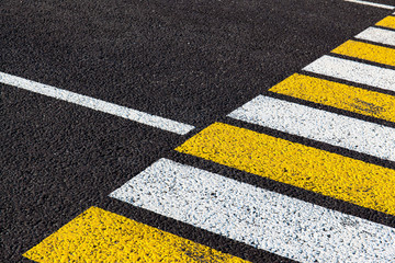 bright markings of a pedestrian crossing on asphalt, background, texture