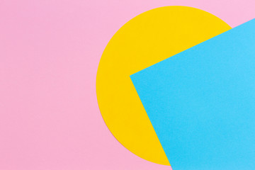 Texture background of fashion papers in memphis geometry style. Yellow, light blue and pastel pink...
