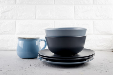 Set of clean tableware on  gray concrete background