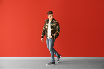 Fashionable young man near color wall Wall mural