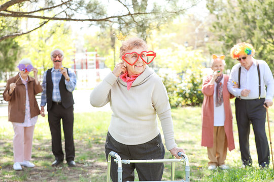 Happy disabled senior woman celebrating Birthday in park