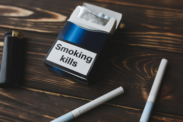 Smoking kills sign on the pack of cigarettes. Dangerous habit. Harmful for health.