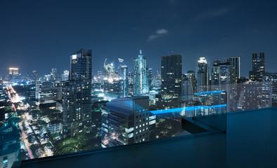 Fotomurales - Open roof top balcony with cityscapes night view .