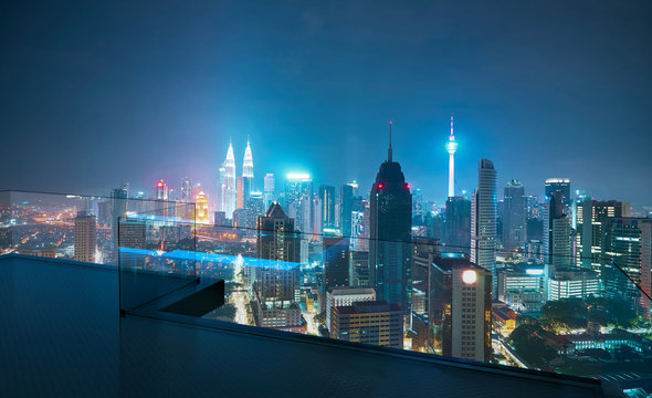 Open roof top balcony with cityscapes night view .