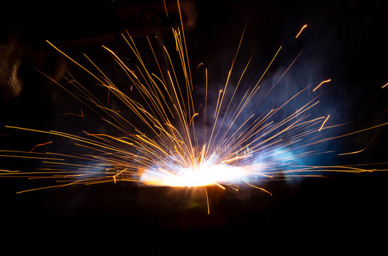 Sparks from welding at a construction site as a background