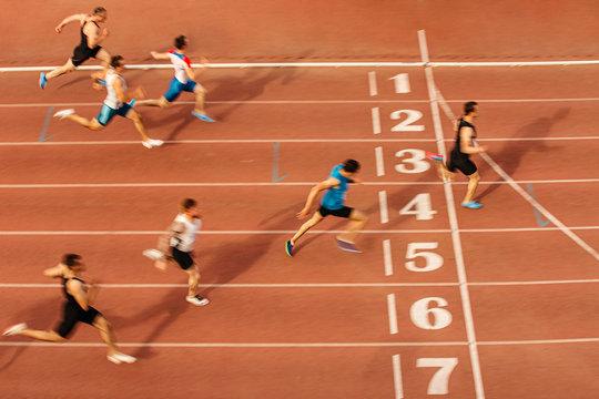 finish line man runners sprinters run 100 meters race athletics