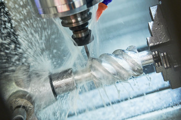 CNC milling machine work. Coolant and lubrication in metalwork industry