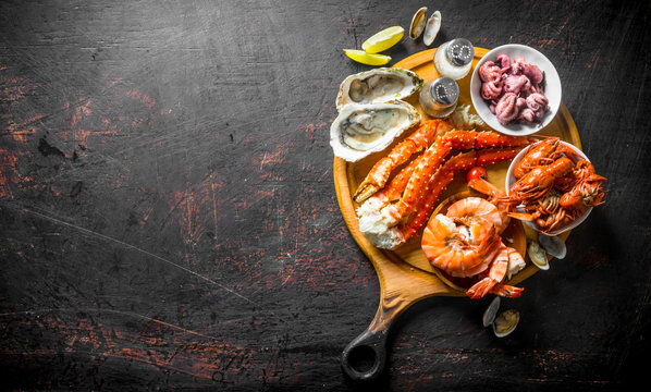 Fresh seafood on a cutting Board with lime and spices.