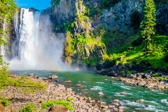 Clear Skies and Double Rainbow Over Snoqualmie Falls in Washington