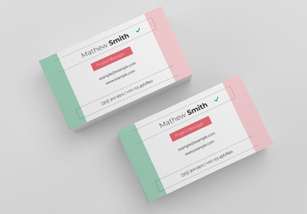 Business Card Layout with Pastel Green and Red Accents