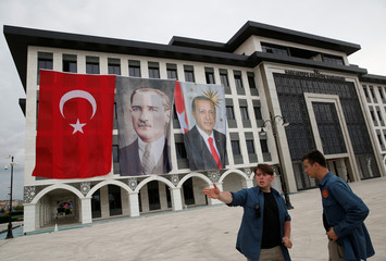 Sancaktepe Municipality building is decorated with a Turkish flag and pictures of modern Turkey's founder Ataturk and Turkish President Tayyip Erdogan during a ceremony in Istanbul