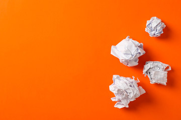 Flat lay composition with crumpled paper balls on color background, space for text