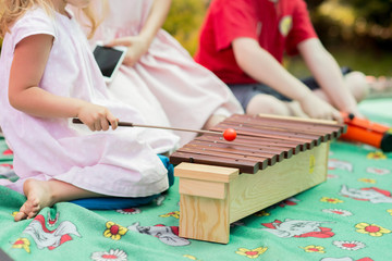 Baby girl playing a musical instrument xylophone