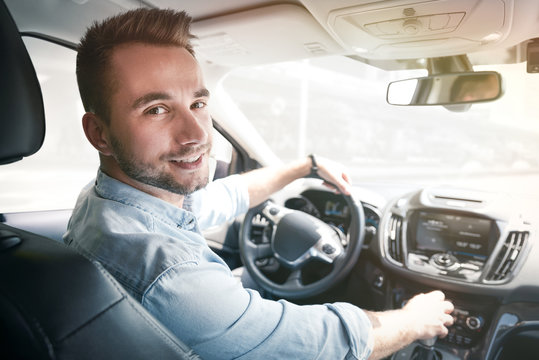 Young male driver behind the wheel