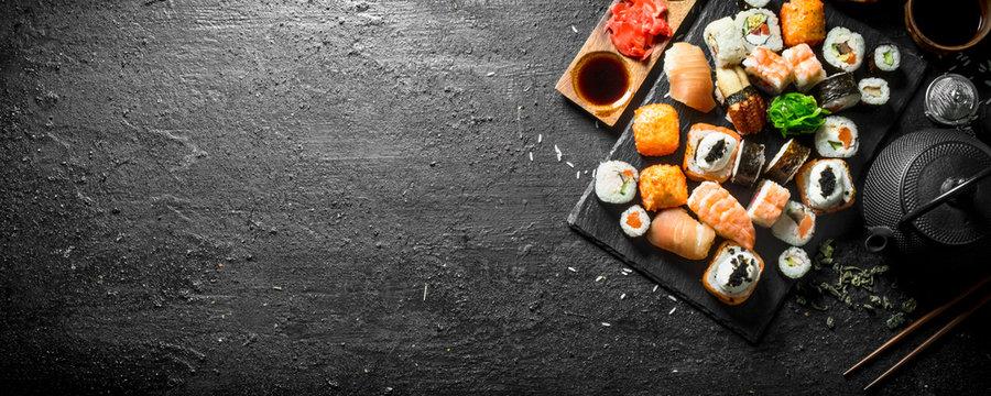 Japanese sushi rolls with salmon, avocado and shrimp.