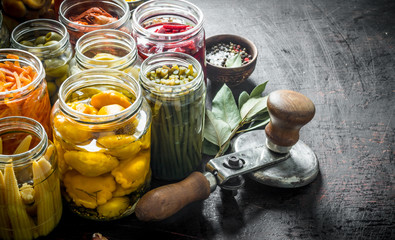 Various preserved food in jars with Bay leaf.