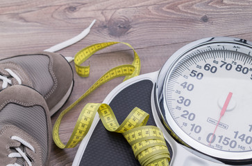 Tape measure, running shoes and weighing scales