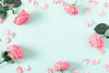 Beautiful flowers composition. Pink rose flowers on pastel mint background. Valentines Day, Easter, Birthday, Mother's day. Flat lay, top view, copy space