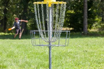 Man throwing frisbee playing disc golf