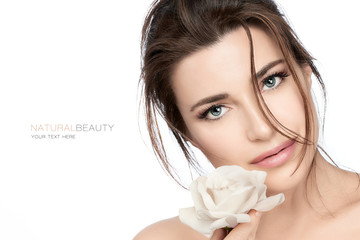 Beautiful young woman with white rose. Skincare and healthy cosmetology concept Wall mural