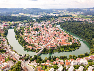 Aerial view of red roofs of Novo Mesto, previously Rudolfswerth or Newestat, Slovenia, Lower Carniola region, near Croatia. Historic Kandija iron bridge Old Bridge, on the bend of the Krka River