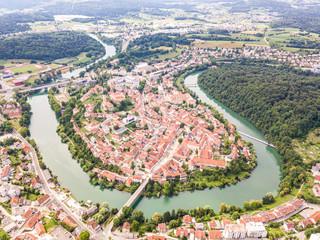 Aerial view of red roofs of Novo Mesto, previously Rudolfswerth or Newestat, Slovenia, Lower Carniola region, near Croatia. Historic Kandija iron bridge Old Bridge, on the bend of the Krka River