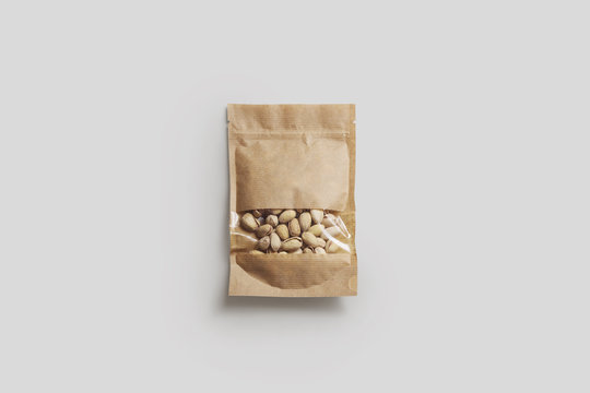 Pistachio Nuts in a paper bag package with window isolated on light gray background.Realistic photo.3D rendering.